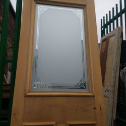 image of door with window in the middle that has been stripped off paint
