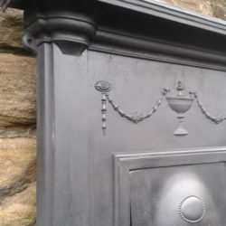 image of stone fire surround being stripped off paint