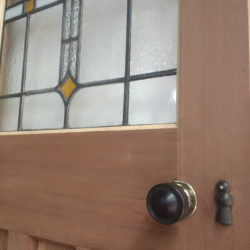 closeup image of door including handle that's been paint stripped